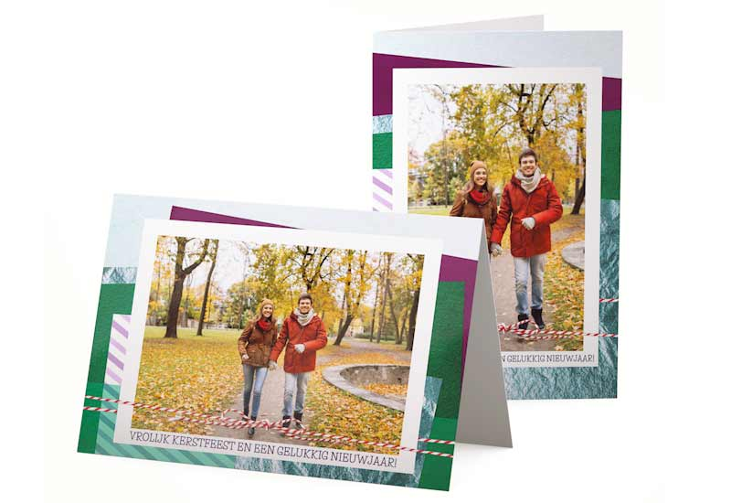 Kerstkaart met foto en laagjes gekleurd papier