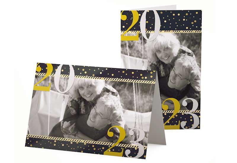 Stijlvolle kerstkaart met foto en groot jaartal